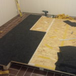 carpet tiles on a wooden floor construction for a home cockpit flight simulator