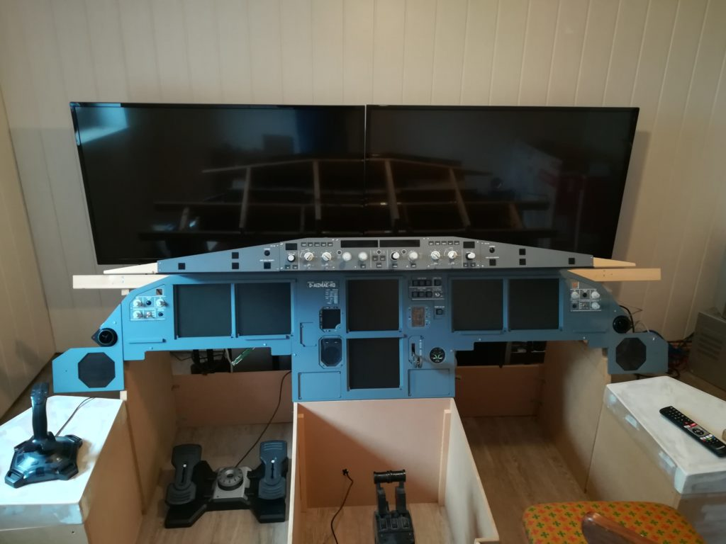 "Homecockpit with two 49"" LED-TVs"